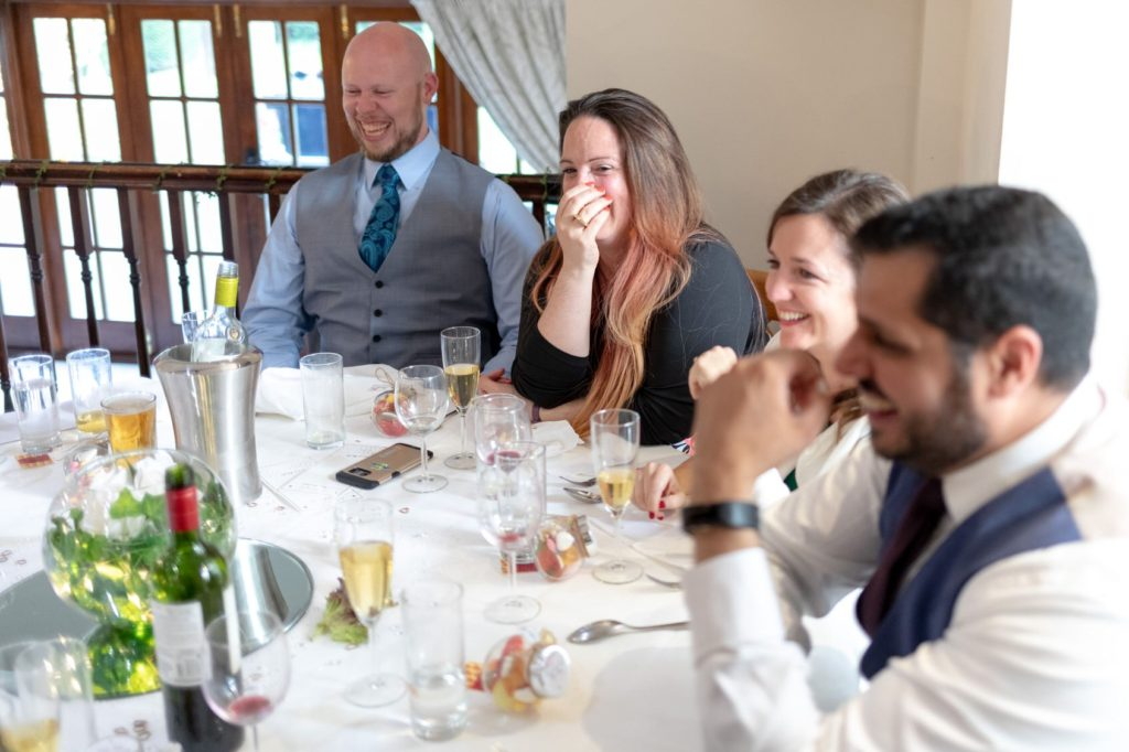 guests laugh at top table speech oaks farm wedding venue surrey oxford wedding photographers