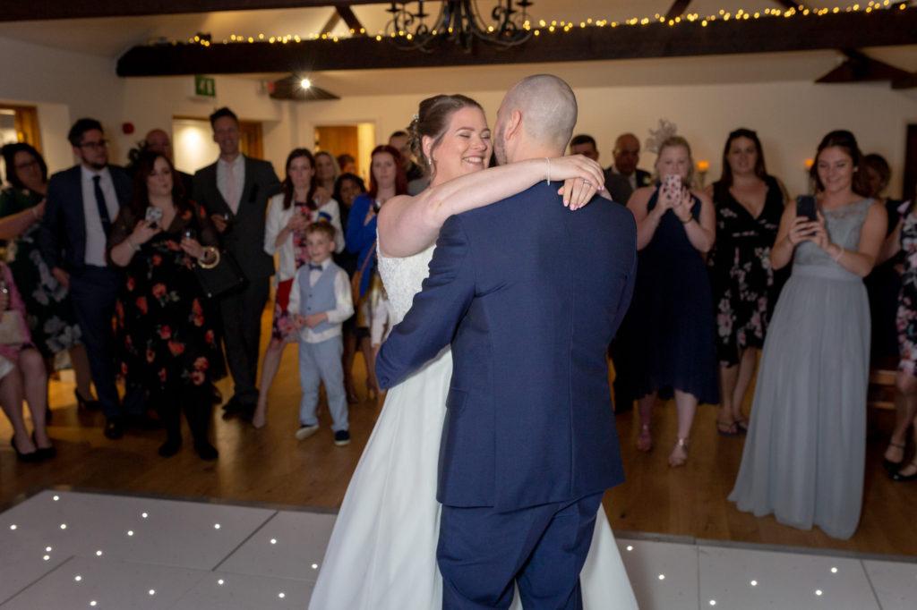 bride groom first dance embrace oaks farm surrey oxford wedding photographers