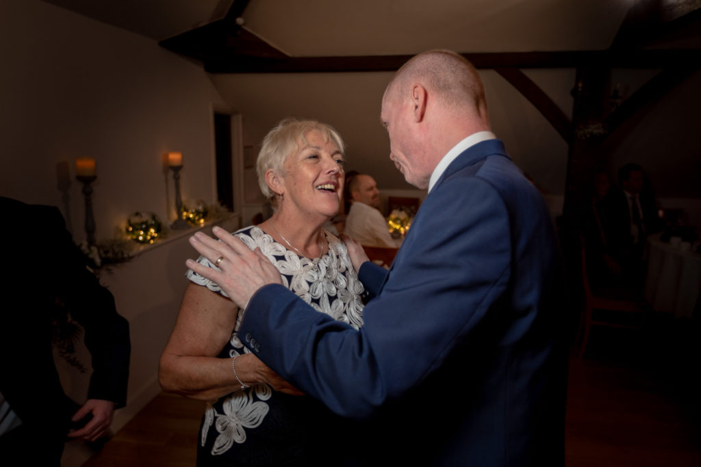 guests dance at celebration party oaks farm wedding venue surrey oxford wedding photographer