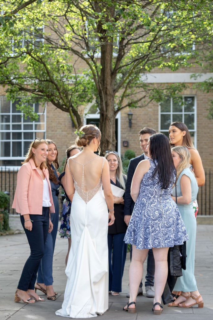 907 bride chats with reception guests st marys church marylebone london oxfordshire wedding photographer