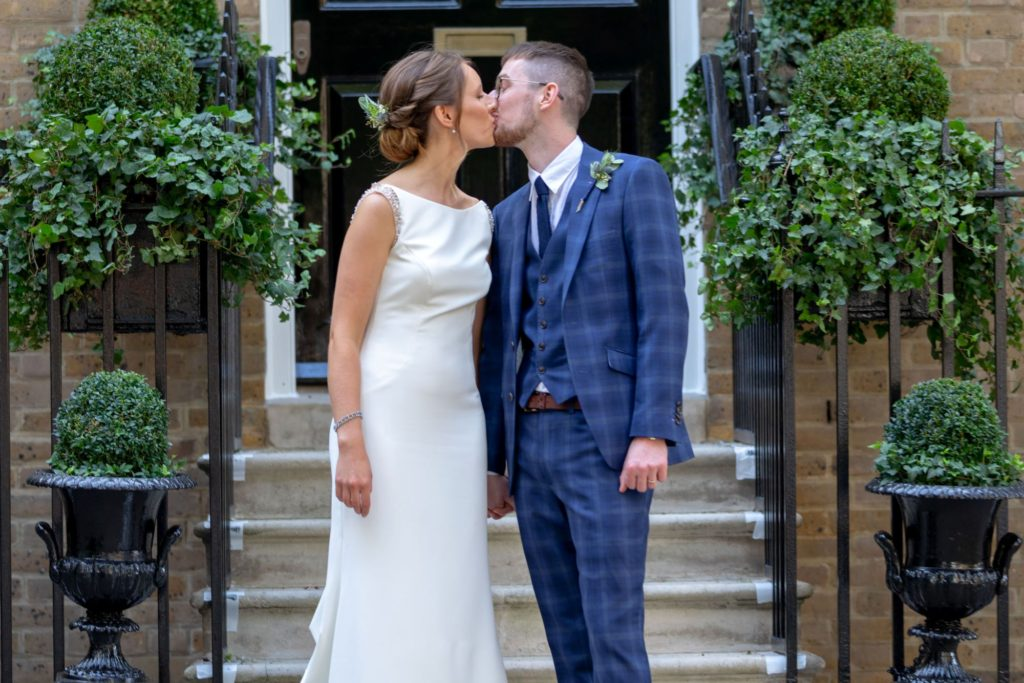 903 bride groom kiss after ceremony st marys church marylebone london oxford wedding photography