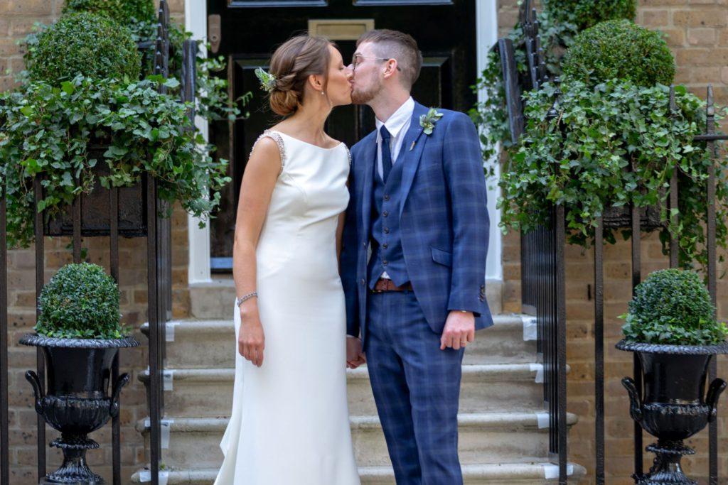903 bride groom kiss after ceremony st marys church marylebone london oxford wedding photography