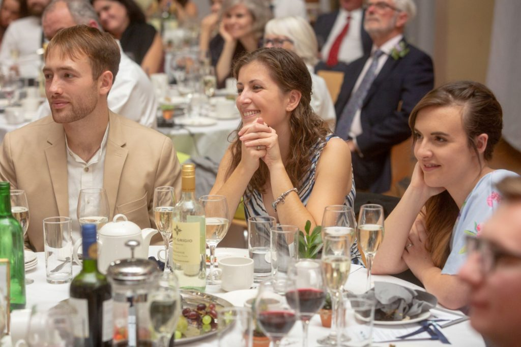 910 guest listens to reception speeches st marys church marylebone london oxford wedding photographer