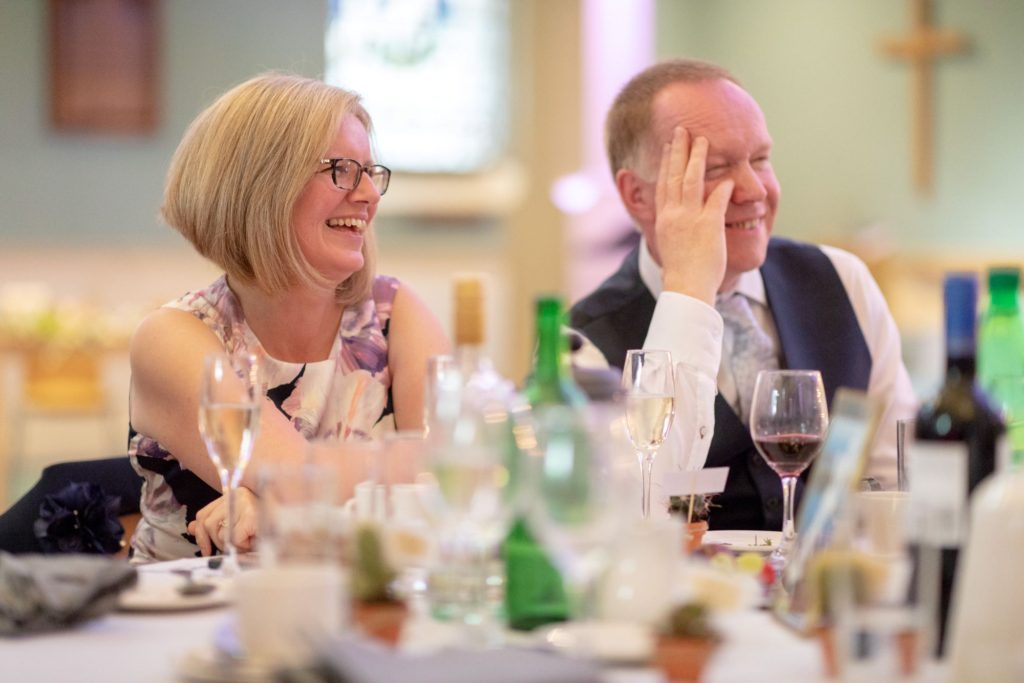 912 father and mother of bride laugh at reception speech st marys church marylebone london oxford wedding photographers