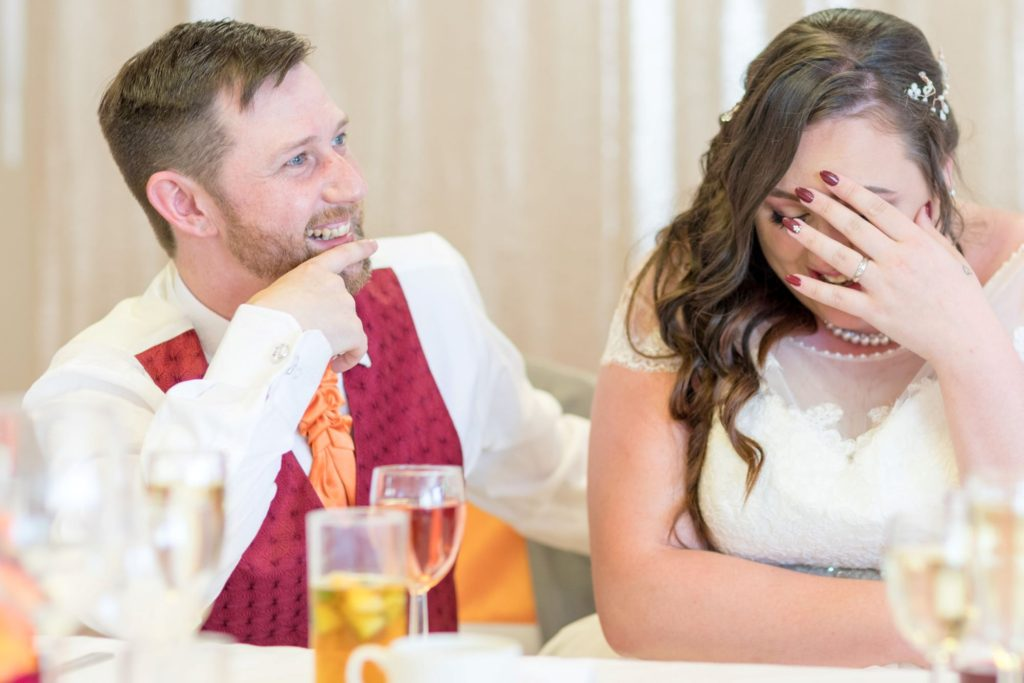 laughing bride groom hear top table speech hellidon lakes resort northamptonshire oxford wedding photographer