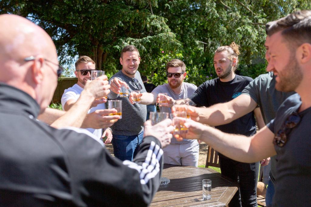 groom bestman groomsmen whiskey toast the elvetham hartley wintney hampshire oxford wedding photographer