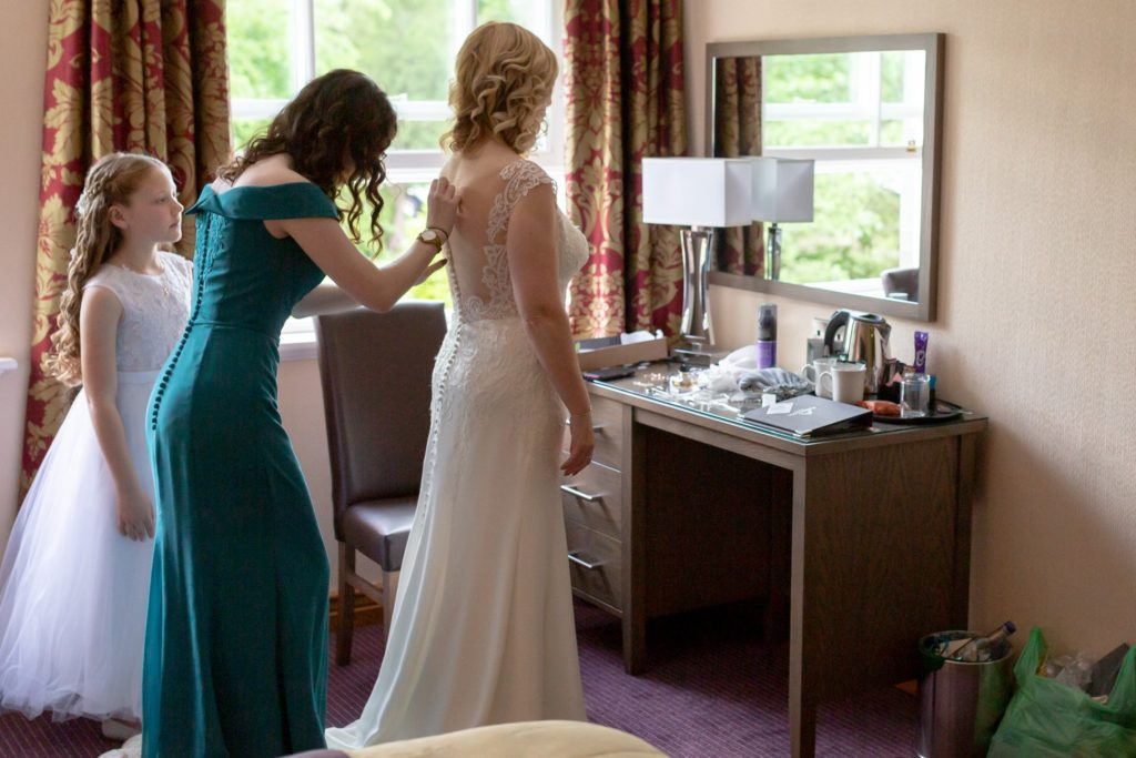 bridal preparation fastening dress ardencote luxury venue claverdon warwick oxford wedding photography