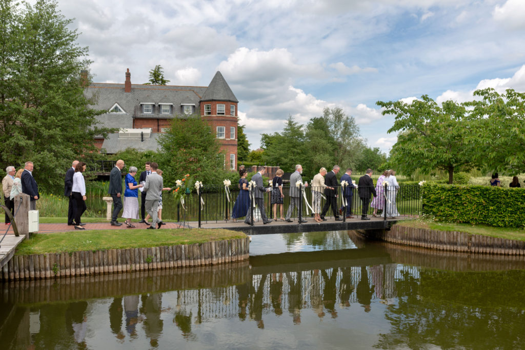 guests cross to island ceremony ardencote luxury venue warwickshire oxford wedding photographer
