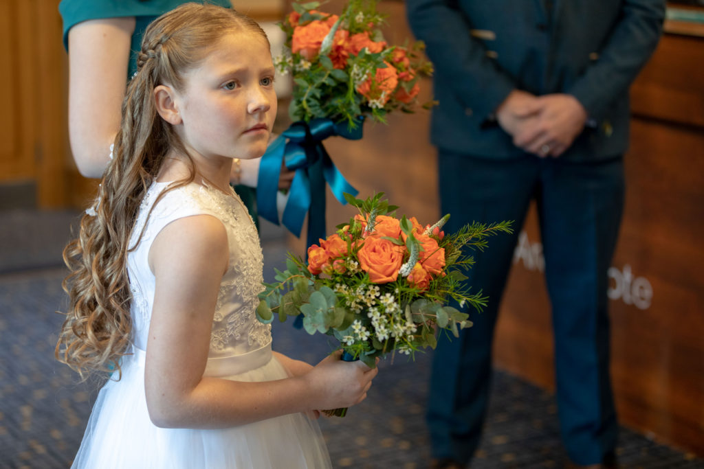flowergirl with colourful bouquet ardencote luxury venue warwickshire oxford wedding photographers
