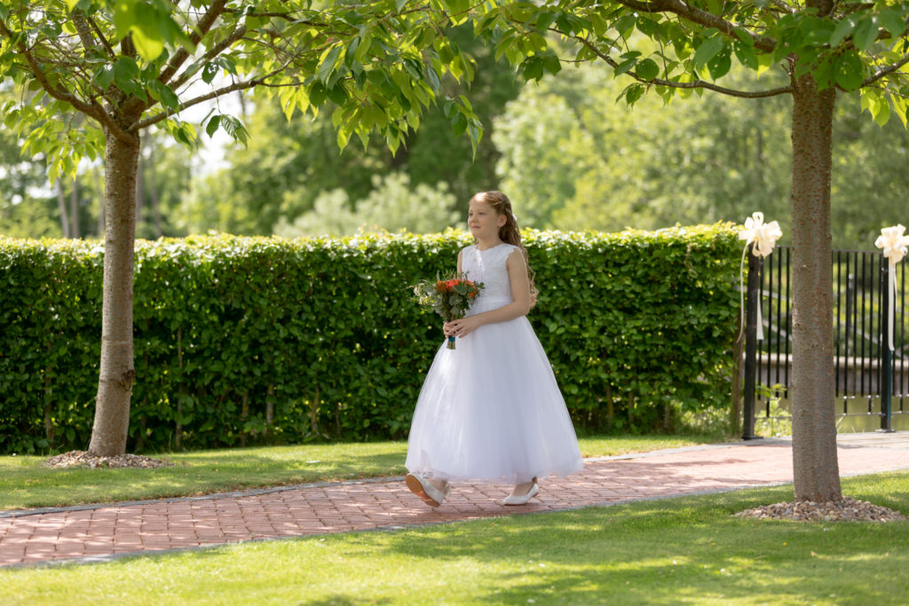 flowergirl walks to ceremony ardencote luxury venue warwick oxfordshire wedding photographer