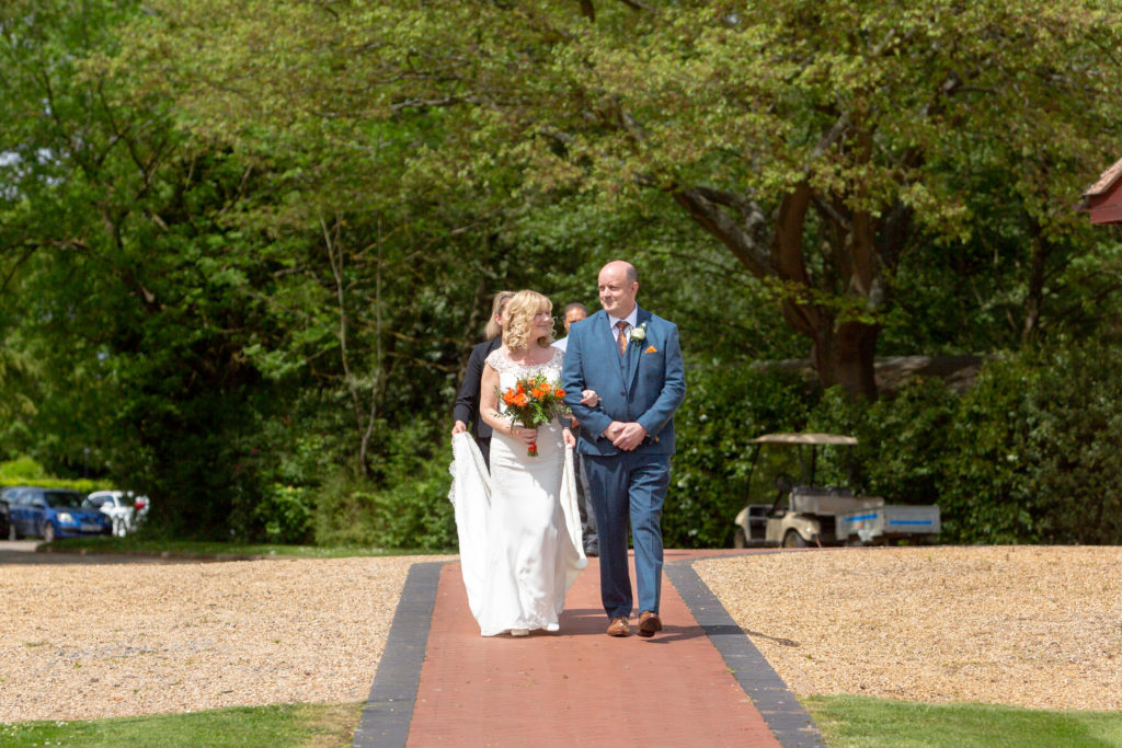 father and bride walk to ceremony ardencote luxury venue warwickshire oxfordshire wedding photographers