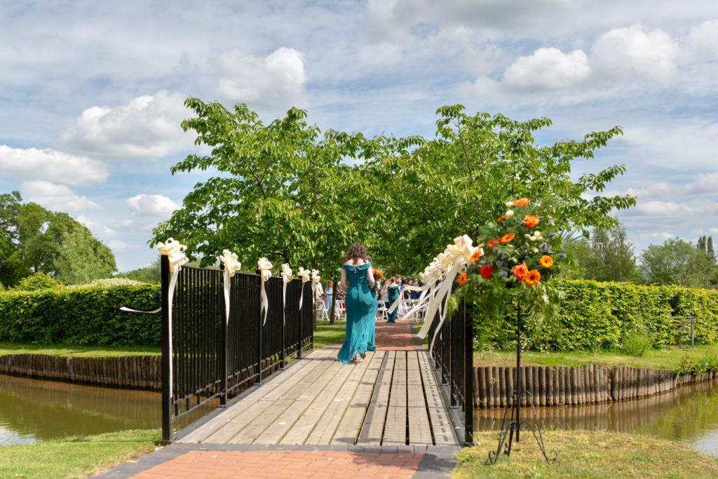 bridesmaids cross island bridge to ceremony ardencote hotel venue warwick oxfordshire wedding photography