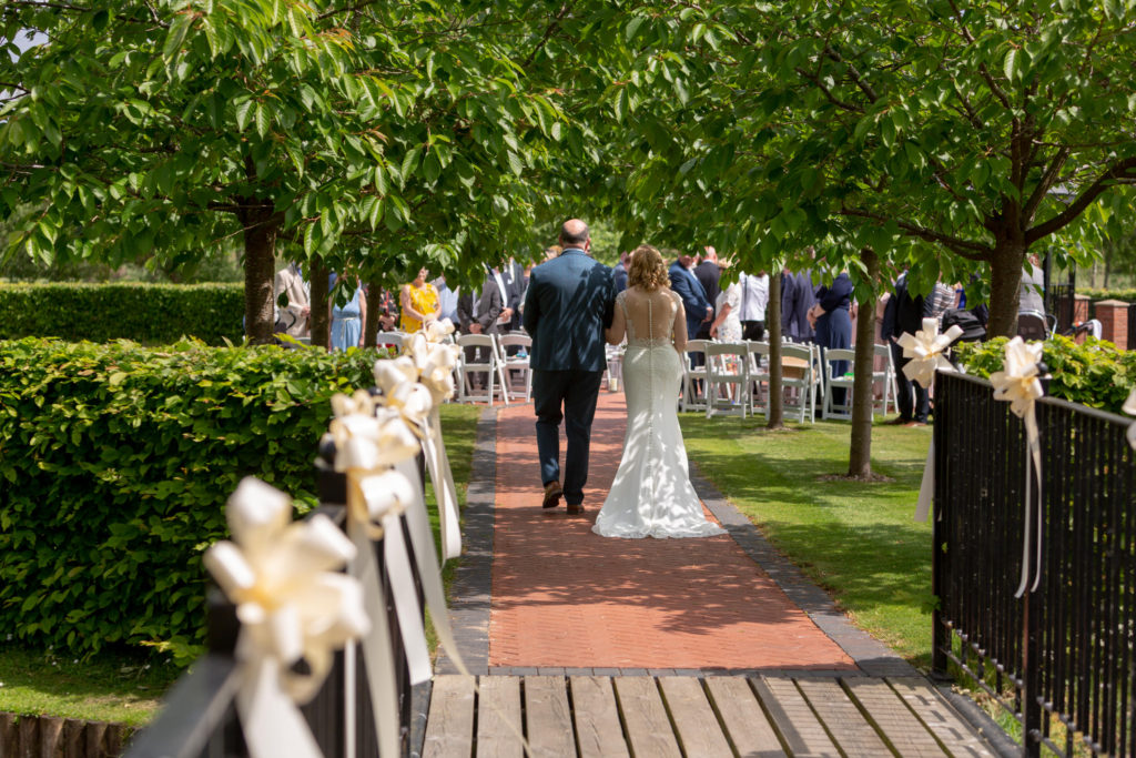 bride and father walk down aisle ardencote luxury venue claverdon warwick oxford wedding photographer