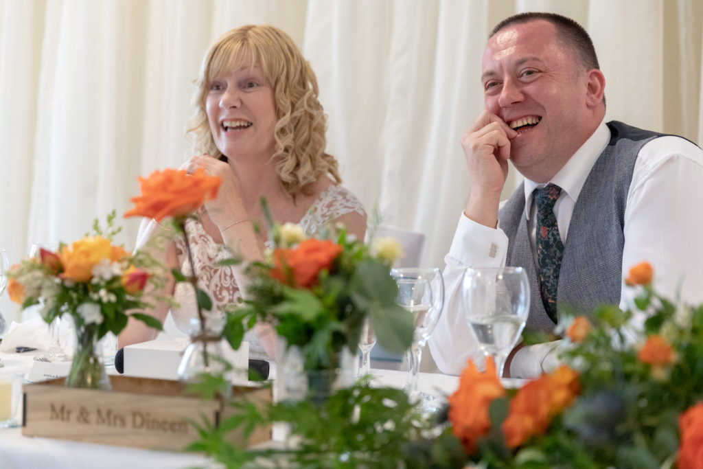 laughing bride groom hear bestmans speech ardencote hotel venue warwick oxford wedding photography