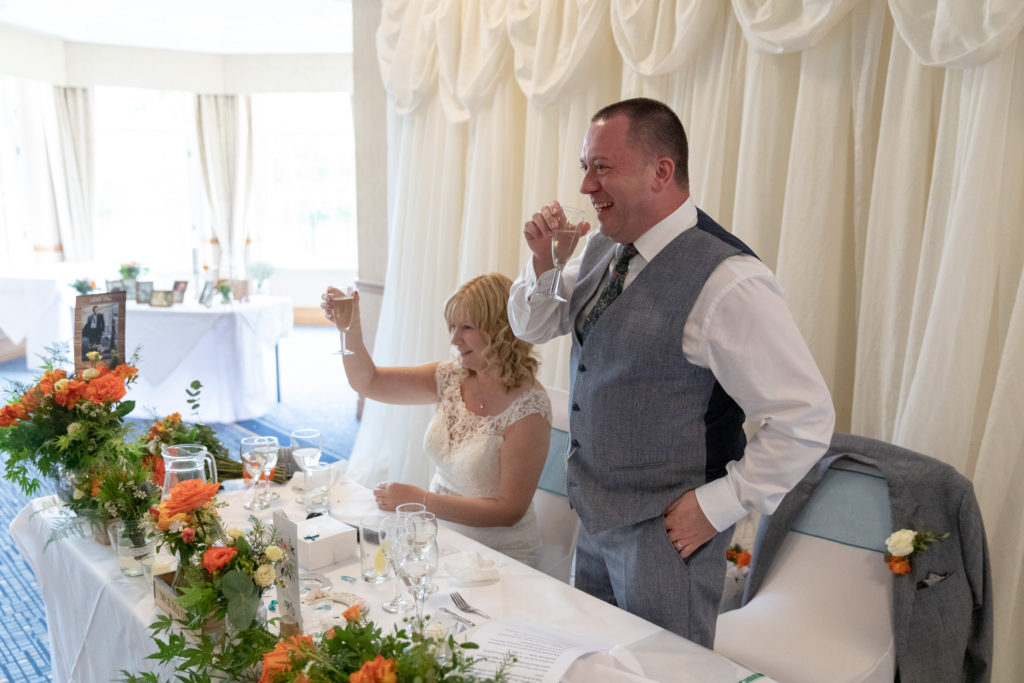bride groom raise champagne glasses ardencote hotel claverdon warwick oxfordshire wedding photographers