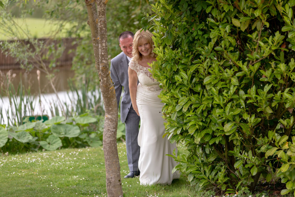 bride groom strolling gardens at ardencote hotel warwickshire oxfordshire wedding photography