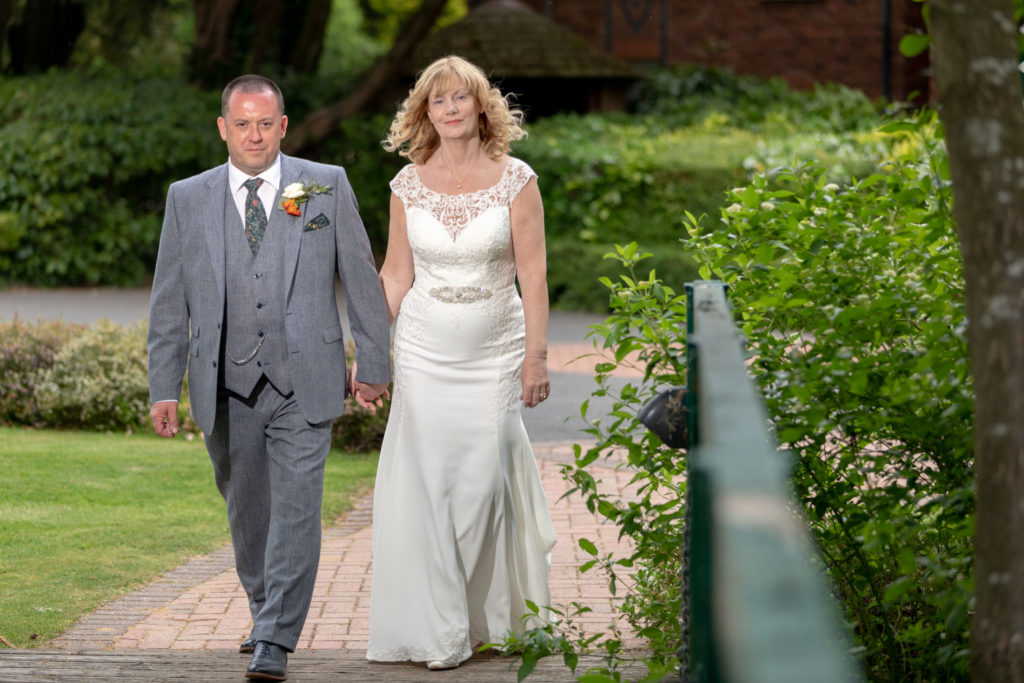 bride groom stroll hand in hand ardencote hotel grounds warwickshire oxford wedding photographers