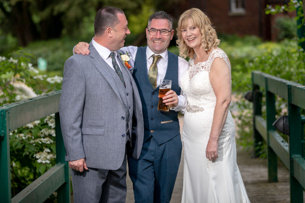 laughing bride groom bestman ardencote luxury hotel grounds warwick oxford wedding photography