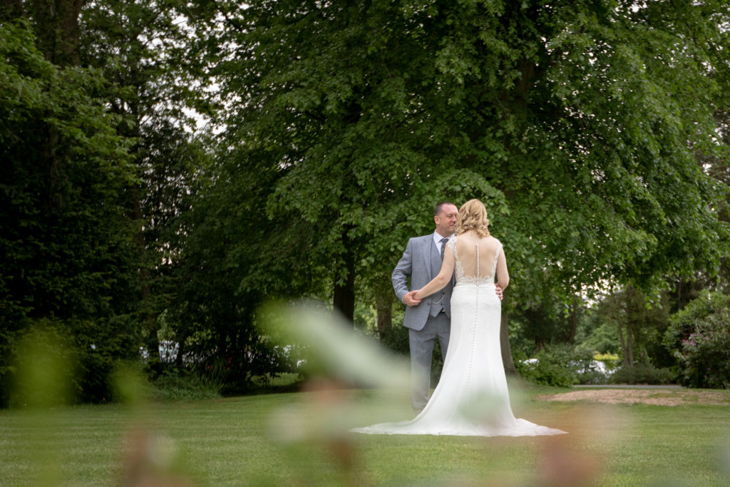 bride groom embrace ardencote hotel gardens claverdon warwickshire oxford wedding photographer