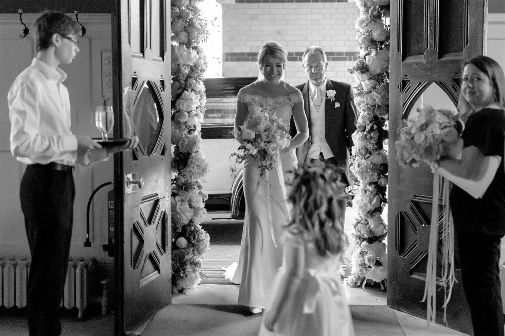 bride father of the bride greeted before marriage ceremony the elvetham hartley wintney hamshire oxford wedding photography