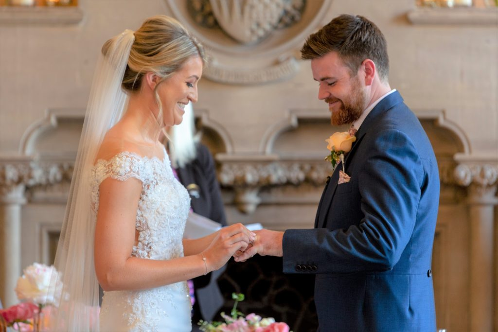 bride groom exchange rings the elvetham luxury wedding venue hartley winthey hampshire oxfordshire wedding photographer