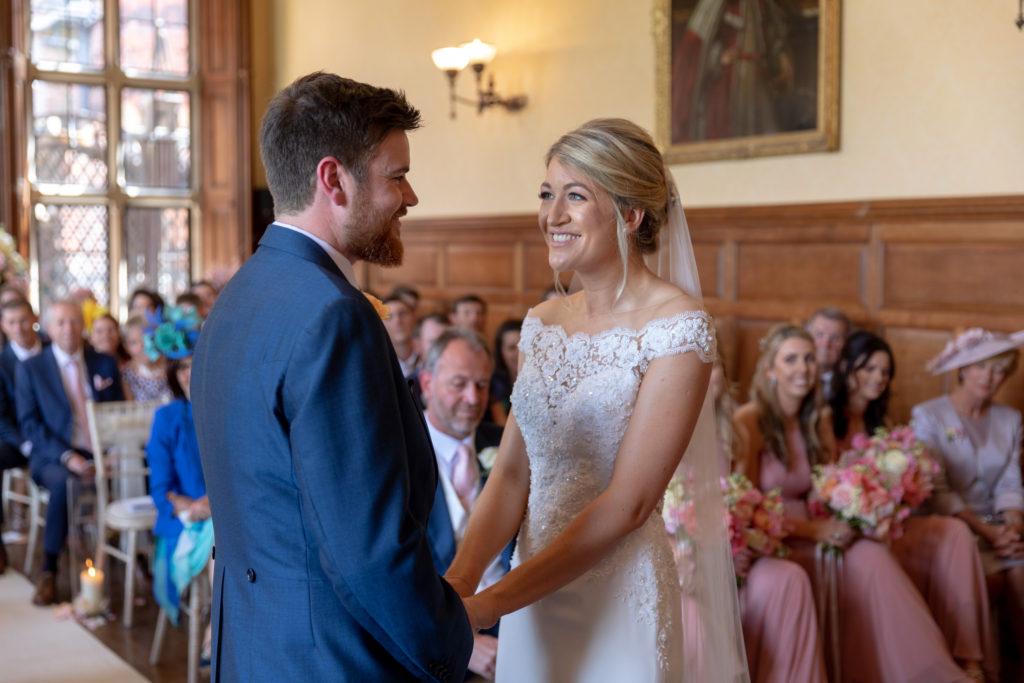 bride groom exchange loving looks marriage ceremony the elvetham hartley wintney hampshire