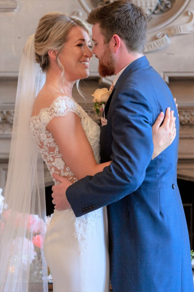 bride groom embrace marriage ceremony the elvetham hartley wintney hampshire oxford wedding photographer