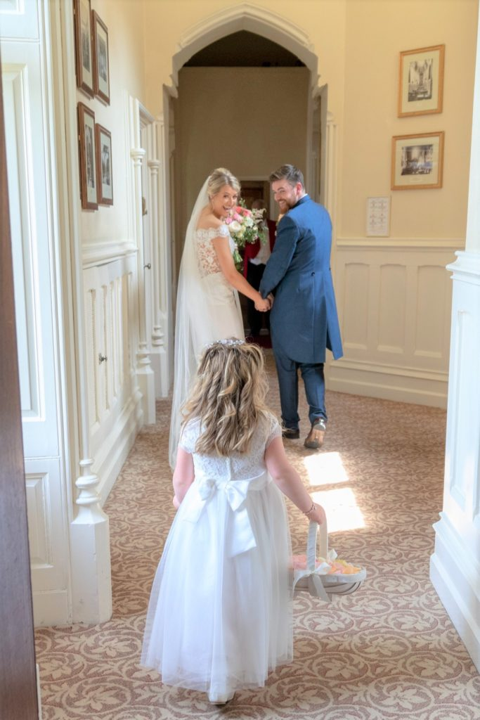 bride groom flower girl the elvetham hartley wintney hampshire oxfordshire wedding photographers