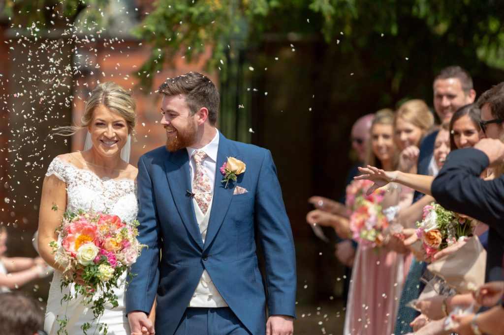 bride groom confetti shower the elvetham hartley wintney hampshire oxfordshire wedding photographers