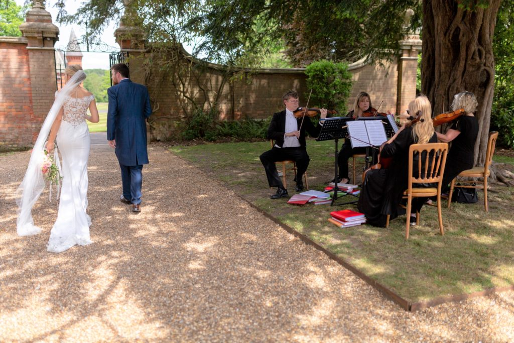 bride groom string quartet the elvetham hartley wintney hampshire oxford wedding photographers