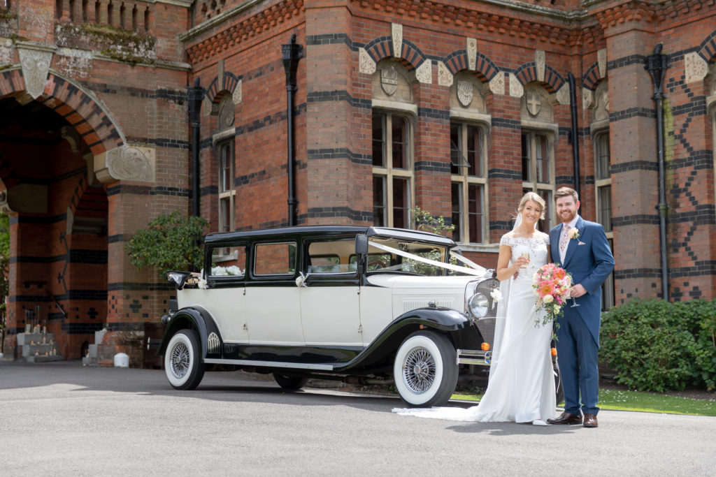 bride groom classic bridal car outside the elvetham hartley wintney hampshire oxford wedding photography