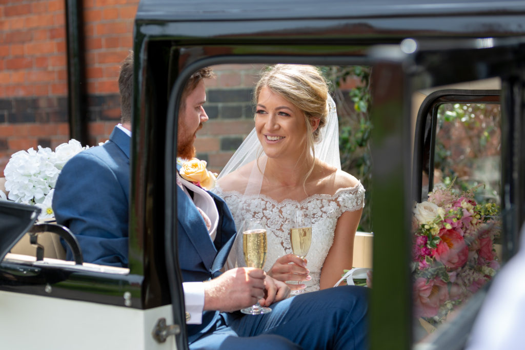 bride groom champagne bridal car the elvetham hartley wintney hampshire oxfordshire wedding photographer
