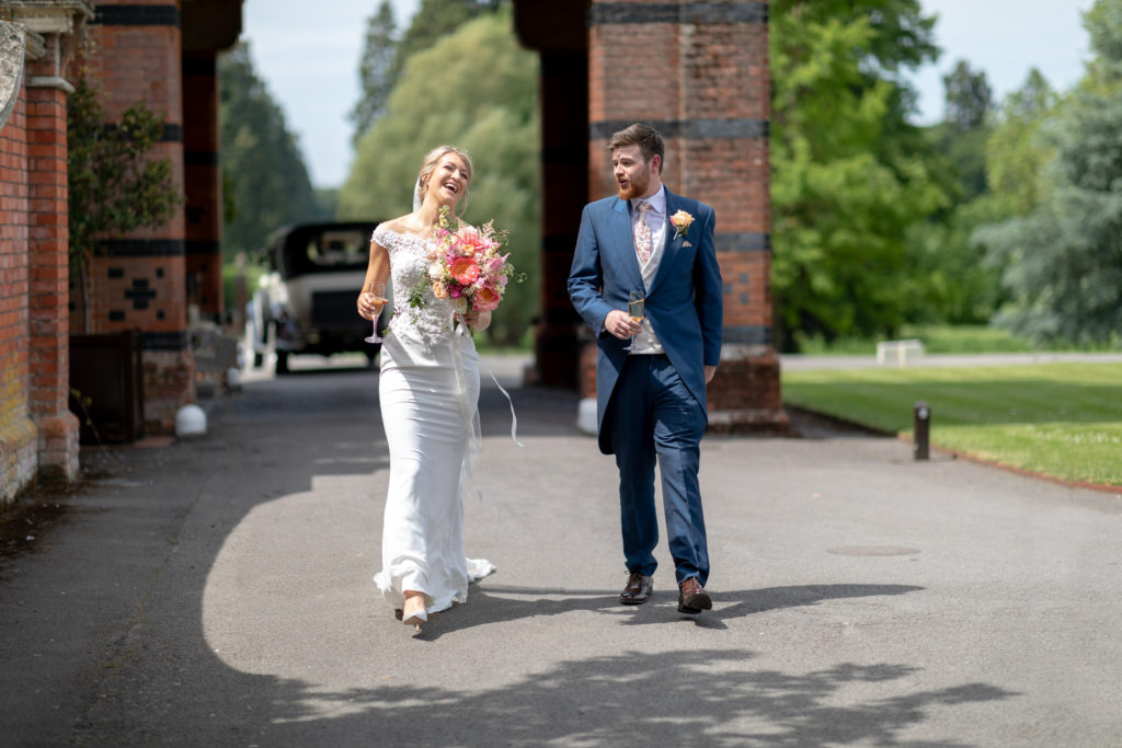bride groom leave bridal car the elvetham hartley wintney hampshire oxfordshire wedding photographers