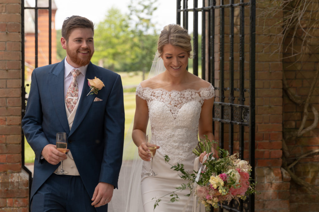 bride groom drink champagne the elvetham hartley wintney hampshire oxford wedding photographer