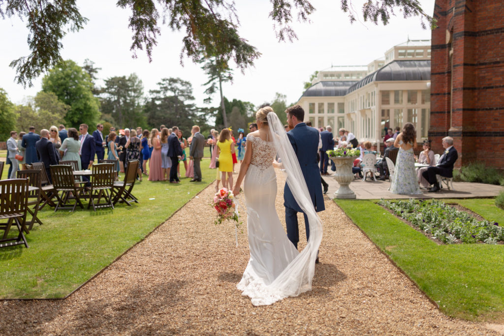 bride groom enter garden reception the elvetham hartley wintney hampshire oxford wedding photographers