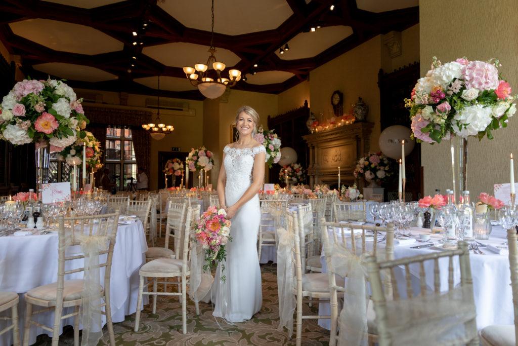 bride reception table floral arrangements the elvetham hartley wintney hampshire oxford wedding photographer