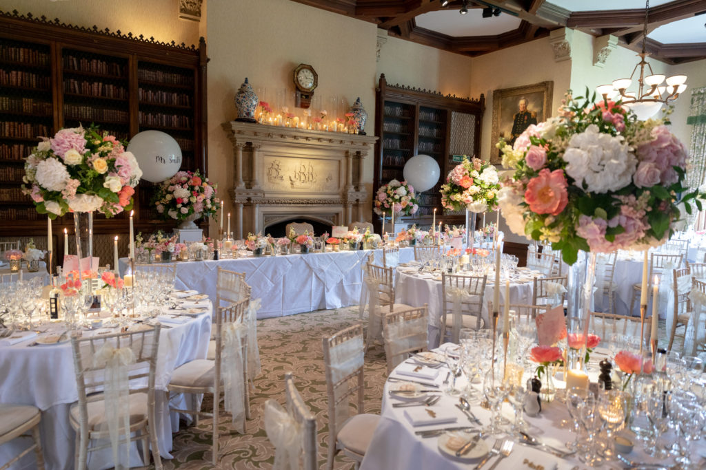 reception dinner table floral arrangements the elvetham hartley wintney hampshire oxford wedding photographers