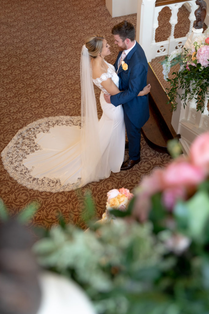 bride groom embrace the elvetham hartley wintney hampshire oxfordshire wedding photographers