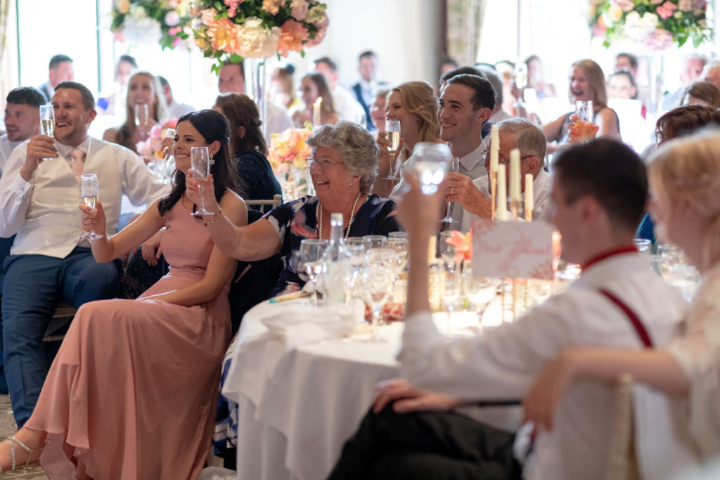 dinner reception guests raise glassed the elvetham hartley wintney hampshire oxfordshire wedding photographer