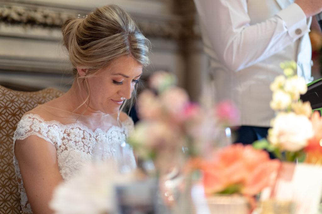 bride listens to grooms top table speech the elvetham hartley wintney hampshire oxfordshire wedding photographers