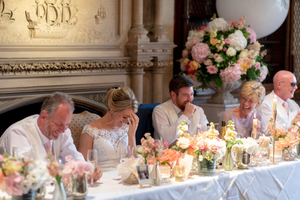 laughing top table guests the elvetham hartley wintney hampshire oxfordshire wedding photography