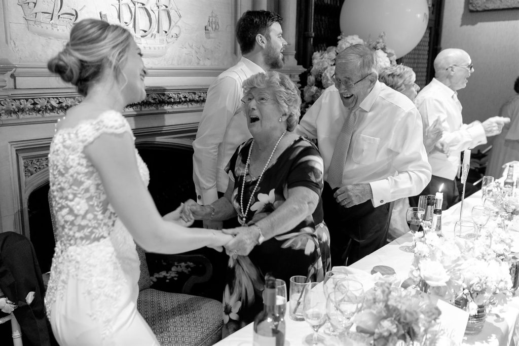 guests dance at reception dinner the elvetham hartley wintney hampshire oxfordshire wedding photographer