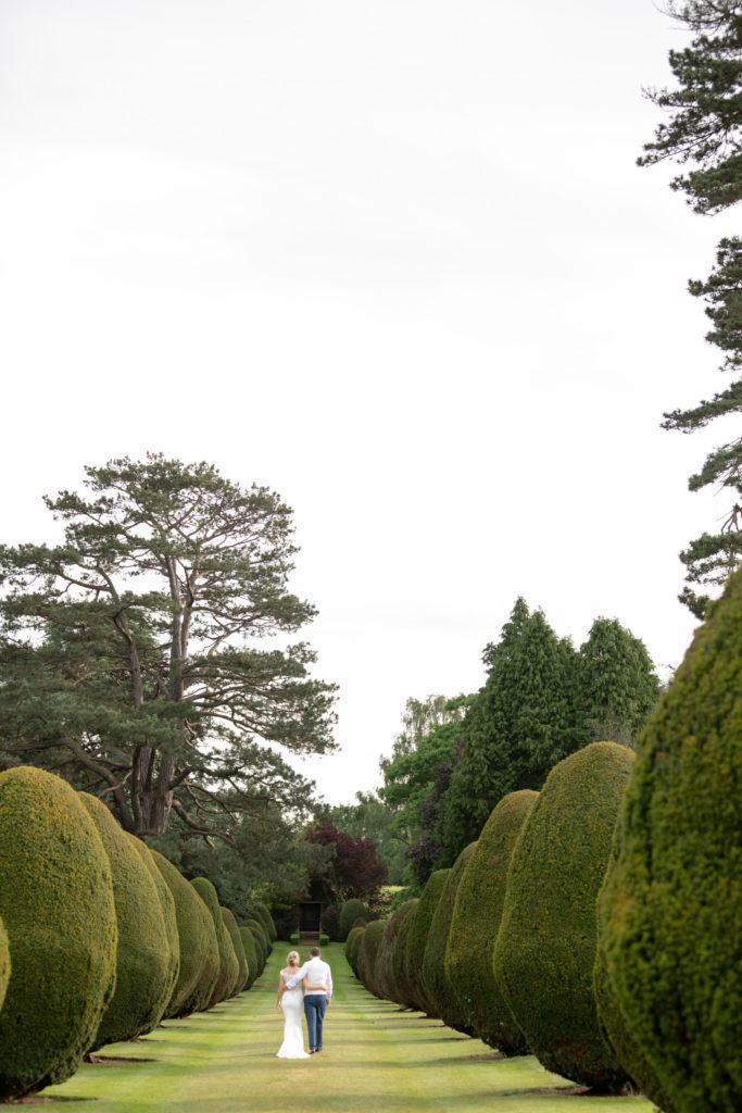 bride groom stroll the elvetharm gardens hartley wintney hampshire oxfordshire wedding photographers