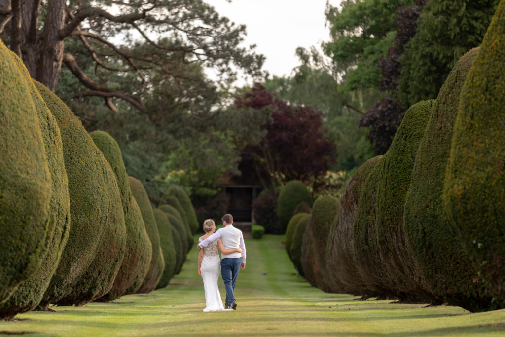 bride groom stroll tree lined walk the elvetham hartley wintney hampshire oxfordshire wedding photography