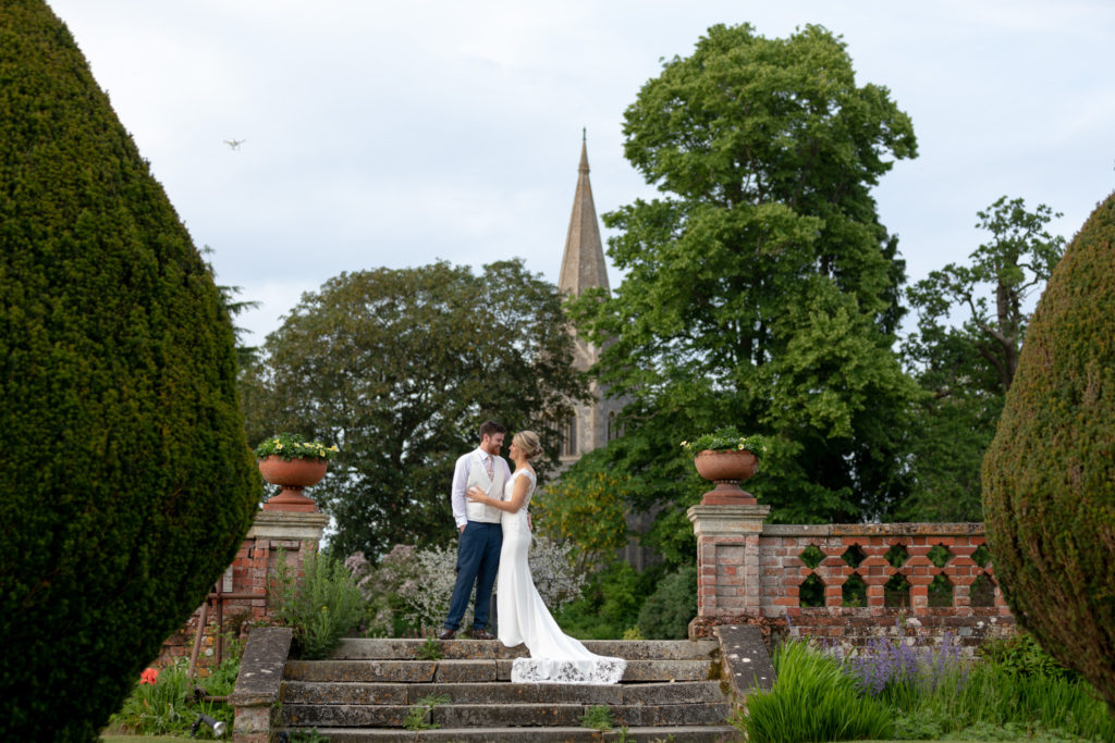 bride groom on garden steps the elvetham luxury venue hartley wintney hampshire oxford wedding photographers
