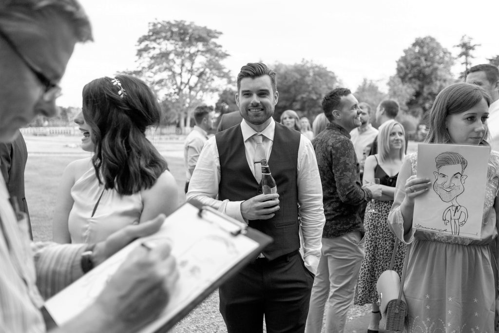 cartoonist sketches reception guests the elvetham luxury venue hartley wintney hampshire oxfordshire wedding photographer