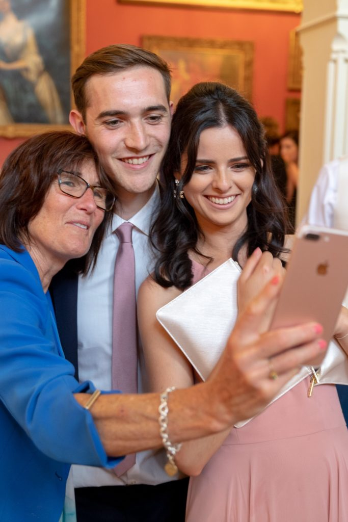 reception guests take selfie the elvetham hartley wintney hampshire oxfordshire wedding photography