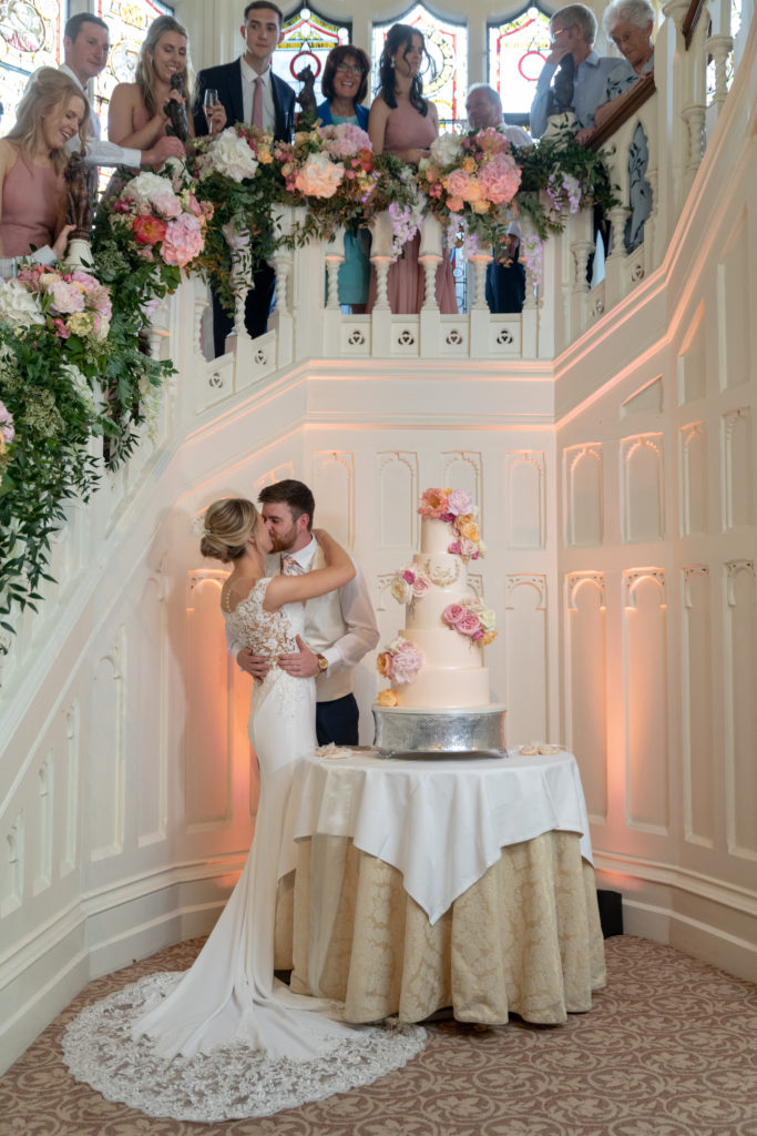 guests watch bride groom kiss cake ceremony the elvetham hartley wintney oxford wedding photographer