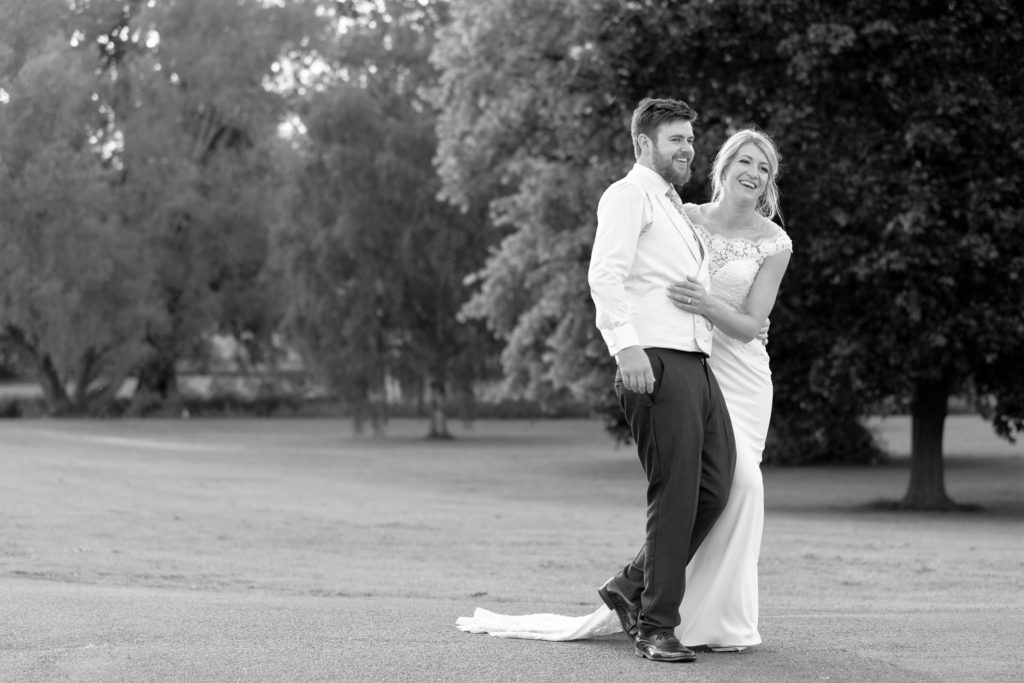 laughing bride groom embrace the elvetham gardens hartley wintney hampshire oxford wedding photographers