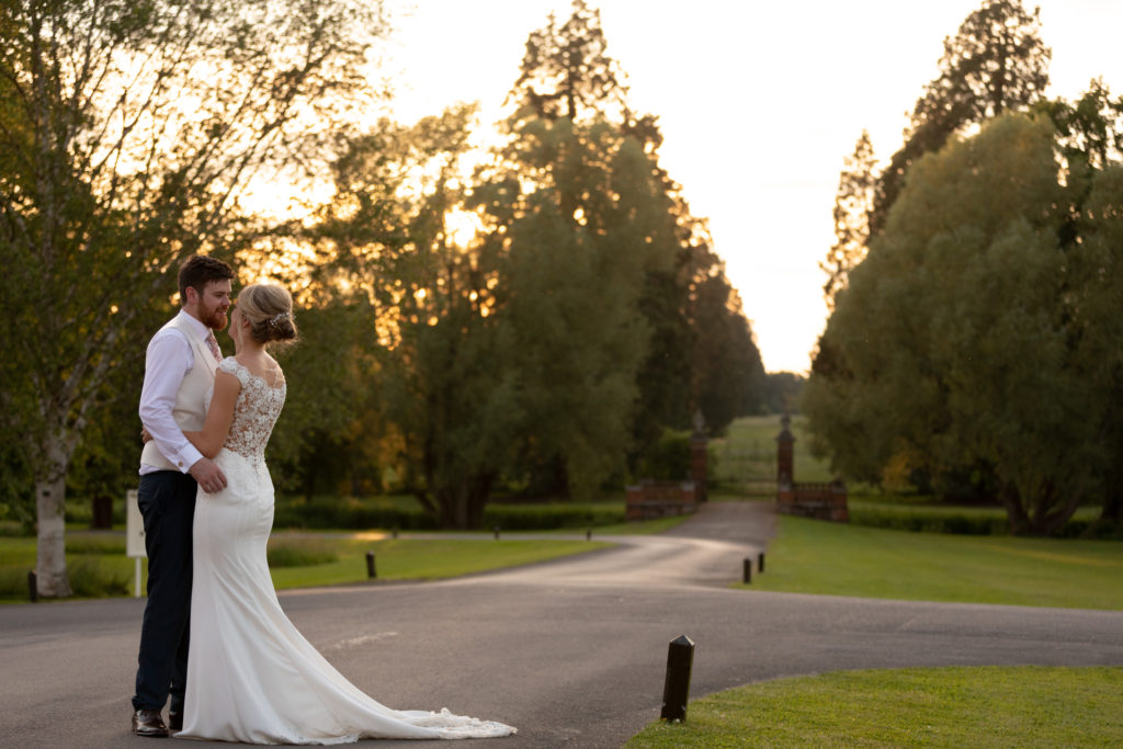 bride groom embrace at sunset the elvetham gardens hartley wintney hampshire oxford wedding photography